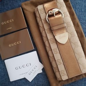 Authentic Gucci Buckled Monogram Clutch